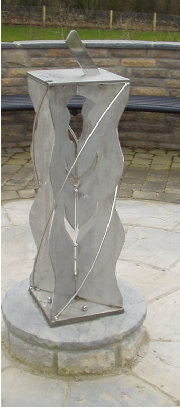 "stainless sundial on a ""thistle-design"" stainless plinth"